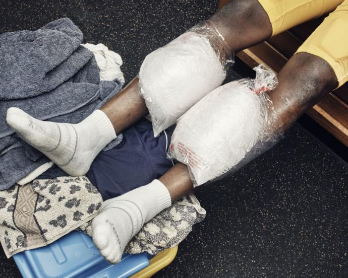 """A player ices his shins after a game. Before one kickoff, Harriott offered the team some final words: """"Leave a mark forever on this field. The St. Thomas spirit should never leave here. They should never, ever want to see blue-and-gold again."""""""