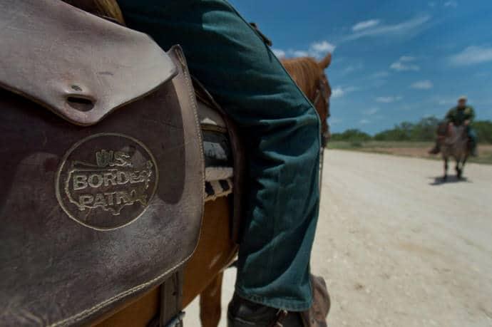 U.S. Border Patrol agents on horseback near Carrizo Springs, Texas.