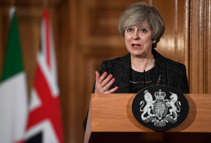 Prime Minister Theresa May's recent claims that leaving the E.U. would enhance Britain's standing in the world have come under ridicule.