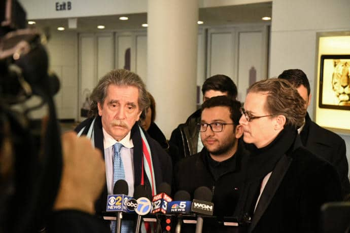 Dr. Amer Al Homssi with his lawyers at Chicago-O'Hare International Airport, after his return from the United Arab Emirates on Thursday.