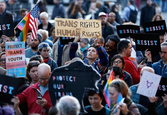 Demonstrators rally outside New York City's Stonewall Inn for transgender rights, which under Donald Trump will lose the backing they had under President Obama.