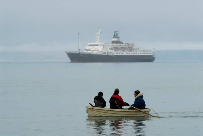 The presence of cruise ships in the Northwest Passage is among the dilemmas that climate change is creating for Canada's Inuit people amid their struggle to balance environmental and economic concerns.