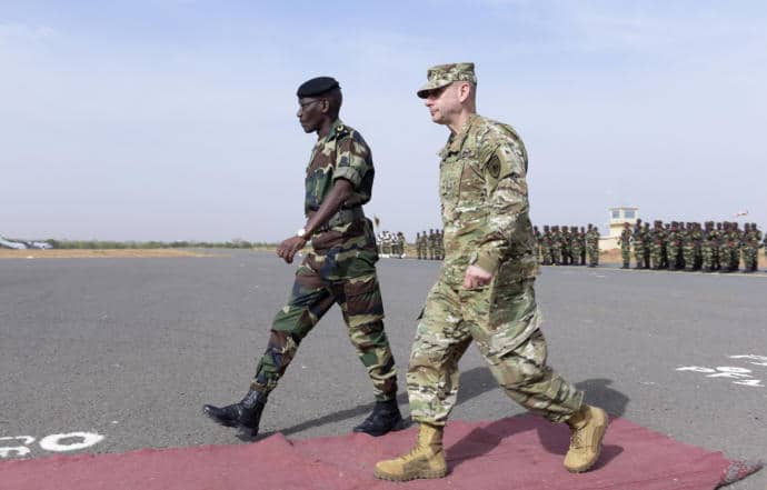 Senegal's Army General Amadou Kane, left, walks with U.S. Army Brigadier General Donald Bolduc during the inauguration of a military base near Dakar, in Senegal.