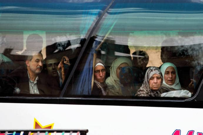 The Trump Administration's foreign policy has left Syria once again in a state of isolation, characterized by mass civilian suffering. Pictured are residents of Palmyra, forced to flee the Islamic State's advance.