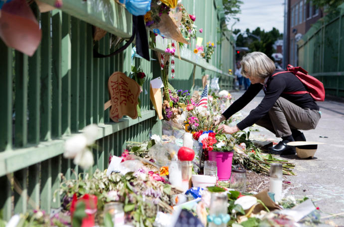 Visitors to the Hollywood Transit Center, in Portland, Oregon, commemorate the deaths of Taliesin Namkai-Meche and Ricky Best, who were stabbed when they came to the aid of two young girls.